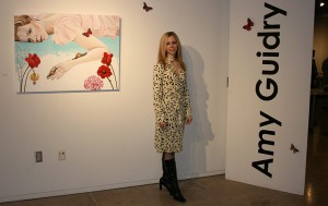 Amy Guidry with her work at the Acadiana Center for the Arts