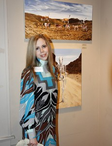 Artist Amy Guidry with her paintings at Wally Workman Gallery, Austin, TX