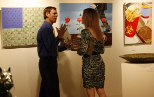 Artist Amy Guidry discussing her work with reporter Kevin Chiri