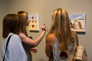 Artist Amy Guidry discusses work with viewers at the Hilliard Museum