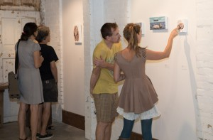 Viewers discussing Amy Guidry's paintings at the opening reception, Barrister's Gallery, New Orleans, LA
